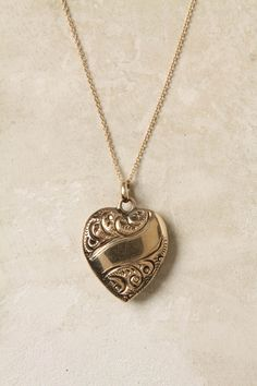In my dreams I live in England, have rolling grassy knolls to romp through with my horses, and wear this locket every day. The queen is my particular friend, we often take tea together, and Kate Middleton wishes she was as cool as me.