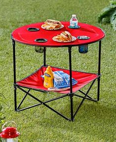Create a home away from home starting with this Folding Camping Table with Shelf. It gives you a tabletop and 4 cupholders for camping, picnics, sporting events and Camping Kitchen Table, Kitchen Table With Storage, Folding Camping Table, Portable Picnic Table, Kitchen Decor, Go Camping, Outdoor Camping, Camping Hacks, Camping Setup Ideas