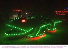 Green night creature at Burning Man