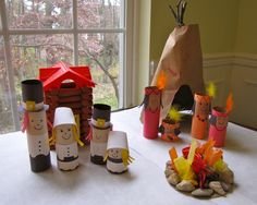 Thanksgiving play set with cardboard tubes, miniature tipi and campfire, as well as book recommendations for the Thanksgiving story. | from Creekside Learning