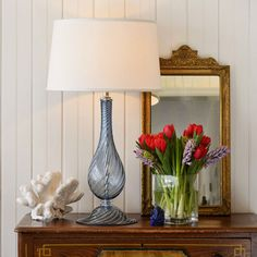beautiful classic interior setting with hand-blown transparent blue Murano glass lamp;  decorating ideas; nautical touches and decor inspiration
