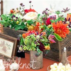 mexican fiesta reception table centerpieces | As a nod to the rustic elegant theme, the couple named each table ...