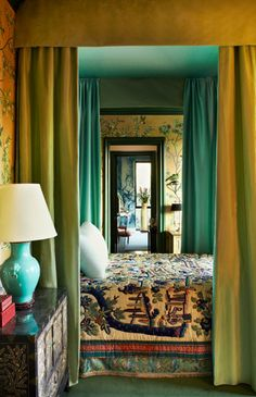 Draperies and door enfilade in a bedroom in Beverly Hills designed by Hutton Wilkinson and Tony Duquette #enfilade #infilata #interiordesign - More wonders at www.francescocatalano.it