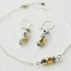 Check out this item in my Etsy shop https://www.etsy.com/uk/listing/505280339/set-dangle-earrings-and-bracelet-elegant