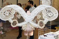 """""""The base is a straw fabric and the wings are covered in old handmade lace that I found in a flea market in France."""" — Juliette Meurisse"""