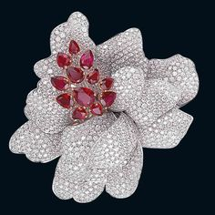 Brooch in white gold, diamonds and rubies by Picchiotti