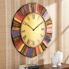 Multicolor Wall Clock Features a large clock face with bold, colorful rays. Round dimensions: in. Clock face: 19 in.