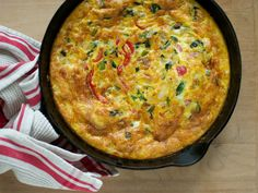 Frittata made with onion, baked potato, green olives, roasted red pepper, roasted mushrooms & asparagus, Monterey Jack, parmesan cheese, and fresh basil   Ree Drummond via Food Network