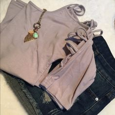 """✨New Listing✨ Women's Peekaboo Sleeve Top. Women's sexy half sleeve peekaboo top. Cute details on arms shows the right amount of skin. ⭐️Color is between a khaki & light gray ⭐️Cotton/ Polyester Blend ⭐️Runs True to Size  (If """"applicable"""" this item includes sales tax reimbursement computed to the nearest mil') Tops"""