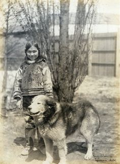 """""""Nancy Columbia, Esquimaux child"""" (with dog) at the 1904 World's Fair."""