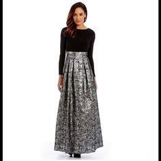 Black Silver Long Sleeve Metallic Brocade Ballgown **Reasonable Offers Welcome** From Cachet, this ballgown features: - round neckline - long sleeves - jersey fabric bodice - bead embellished waist - metallic brorcade skirt with box pleats - concealed back zipper closure  - polyester/spandex - dry clean Cachet Dresses Long Sleeve
