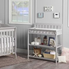 Create a warm and inviting space for your child with the Ashton Changing Table from Dream On Me. Crafted of pine, it features 2 shelves for storing all your baby's essential items. Conveniently, the table can also transition into a nightstand. Open Shelving, Shelves, Diaper Changing Station, Changing Pad, Changing Table Topper, Changing Table Dresser, Kids Bookcase, Mattress Pad, Nursery Furniture