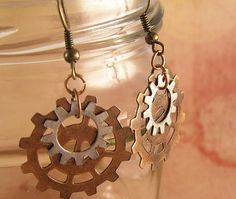 Copper and nickle silver Steampunk Gear earrings! Simple yet fun Steampunk gear earrings. Clockwork gears on copper wire hooks. Small gear 14mm  ( a bit more than 1/2  inch) roundLarge gear 25mm ( 1 inch) roundApproximately 30mm ( 1 1/4  inch) long dangleWhether you are an apothecary or an air ship captain, these earrings will keep you in steampunk style!These earrings would go well with this necklace:http://www.zibbet.com/TheAmethystDragonfly/artwork