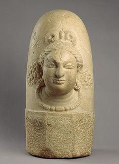 Linga with one face (Ekamukhalinga), Shahi period, 9th century Afghanistan. The linga (phallic emblem of Shiva) symbolizes the great generative force of the universe. When plain (simply phallic), the linga represents Shiva in his most abstract form. In this example, Shiva's face has emerged from the central shaft. He is adorned with earrings and a necklace. His hair is worn in a double bun with a crescent moon on one of the buns.