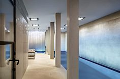 New York - Steven Harris Architects. The 50-foot, L-shaped pool is a showpiece—but the space is also a marvel of engineering. The bedrock was excavated and the entire foundation reinforced. The tiles behind the waterfall were hand-carved. In addition to the pool, the basement holds a wine cellar, a gym, and a workshop.