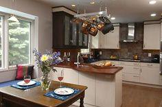 Tile backsplash, black/white cabinets, stone/granite counter tops