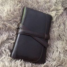 """AUTHENTIC $200 Johnny Farah wallet Pre owned, but zero signs of wear. This wallet is luxurious and amazing!! Soft supple dark brown leather, and plenty of space for everything you need to tote! 6 card slots and a bill pocket, snap closure smaller pocket, pen holder, zipped compartment, and two more slit pockets! 5.5"""" x 8"""" with a leather tie to hold closed. This is a truly amazing artisanal piece. Johnny Farah Bags Wallets"""
