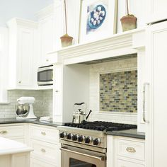 Create a focal point in your kitchen by adding a behind the range back splash with a burst of colour.