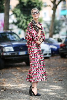 How To Dress Like An Italian Girl — 50+ Lessons Worth Knowing #refinery29  http://www.refinery29.com/2014/09/74945/milan-fashion-week-2014-street-style#slide-80  Everything's slightly off about each item in this outfit — which is what makes it so totally amazing.