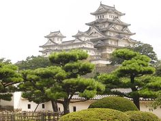 """Himeji-jō (ie: Himeji Castle) is a hilltop fortress located in Hyōgo Prefecture, Japan. The castle is regarded as the finest surviving example of prototypical Japanese castle architecture and dates to 1333.  This UNESCO world heritage site is frequently known as Hakuro-jō (""""White Egret Castle"""") or Shirasagi-jō (""""White Heron Castle"""") because of its brilliant white exterior and resemblance to a bird taking flight."""