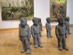 Installation view of works by Jarmo Mäkilä. On the floor in front of the paint… - Modern Concrete Statues, Gnome Garden, School Boy, It Works, Lion Sculpture, It Cast, Flooring, Adolescence, Modern