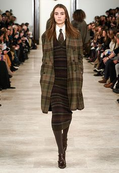 Romy olive plaid cashmere double-breasted topcoat, Fair Isle cashmere vest, off-white silk shirt, plaid tie, Fair Isle cashmere skirt, brown burnished alligator double-monk-strap bootie