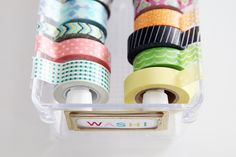 Washi Tape or Ribbon Organizer:  Buy a plastic clear box and two Tension extension rods to fit.  Then attach a serrated edge from an empty plastic wrap container with double sided tape.  Brilliant.