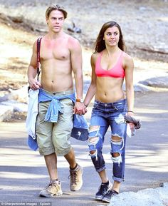 Back to nature: Derek Hough and Hayley Erbert looked to still be in the honeymoon period of their romance, as the couple took a romantic walk through the woods in California