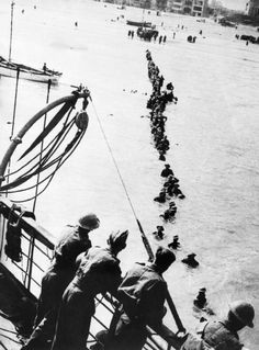 DUNKIRK - May 27/June 4, 1940. British soldiers wade out to a waiting destroyer off Dunkirk during Operation Dynamo. 198,229 men were evacuated, in all 342,400 men returned, 11,000 KIA, 14,070 wounded and 41,000 held as POW's.