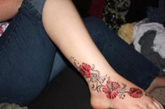 Tattoo with red hibiscuses-shape, thinking pink flowers and softer