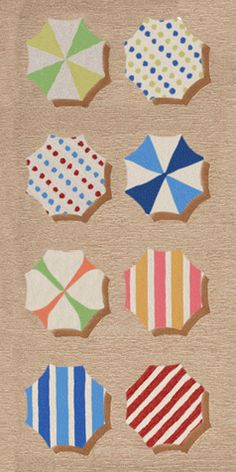 Want a beach feel at your house? Bring the sun and sand home with an umbrella rug!