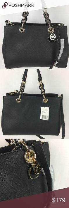 """Michael Kors Cynthia Medium Satchel Black Gold NWT Condition Notes: New. With Tag, Care Card and Dust Bag  Both timeless and on-trend, this satchel is replete with sophisticated details, from its leather-trimmed chain-link handles to the convertible, buckle-fastened shoulder strap. An array of interior pockets and a top-zip closure keep all of your essentials organized and secure. Crafted from sumptuous leather that gets better with time, it's the ideal everyday bag. 12-1/2"""" W x 9-1/4"""" H x…"""
