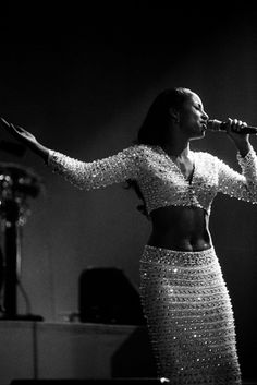 ROTTERDAM, NETHERLANDS - 26th APRIL: English singer Sade performs live on stage at Ahoy in Rotterdam, Netherlands on 26th April 1993. (Photo by Paul Bergen/Redferns)
