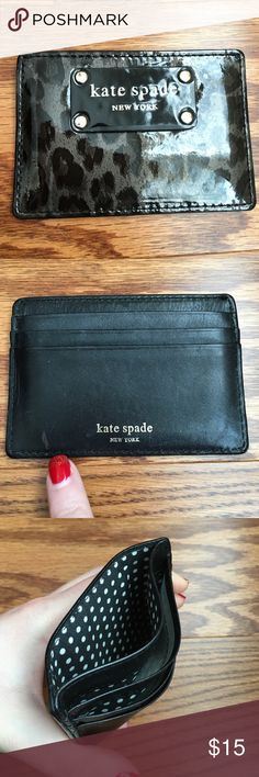 Kate Spade Card Holder Used Kate Spade  black and gray leopard print card holder with 4 slots and each slide can hold at least two cards. Had a stain in the left lower corner as showed in the second picture and a few faint flaws. Letters in the front started to faint especially letter P (as seen on the last picture). The inside condition is very good! Very cute and practical card holder to carry ID and and a few credit/business cards. kate spade Bags Wallets