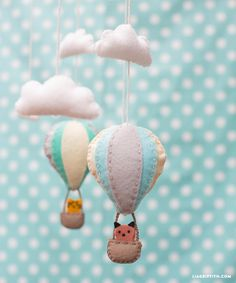 Decorate your baby's room with this cute DIY baby mobile made from felt. Download the pattern and tutorial from handcrafted lifestyle expert Lia Griffith.