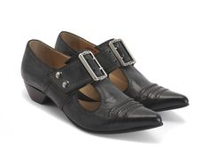 """For his 40th Anniversary, John is re-issuing his favourite styles from each decade, for a limited time, to celebrate with the world 40 years of Unique Soles for Unique Souls. A super pointy-toed, buckled t-strap loafer with stitched wrinkled leather on the instep, The Pilgrim shoe was one of John's first women's designs which took its initial inspiration from the Victorian era. The updated design includes a rubber sole plate, 1.25"""" leather wrapped heel, gold lining, and features…"""