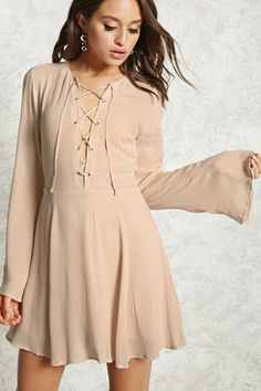 A woven mini dress featuring a front self-tie lace-up design, long bell sleeves, a hidden back zip closure, and a flowy silhouette.
