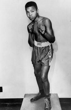 Boxer Cassius Clay is shown in 1954. Long before his dazzling footwork and punching prowess made him a three-time world heavyweight boxing champion known as Muhammad Ali, a young Clay honed his skills by sparring with neighborhood friends and running alongside the bus on the way to school.