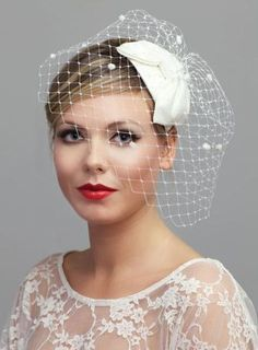 1950s Silk bow headdress and detachable birdcage veil with dots,white,ivory,champagne,black,blue. $205.00, via Etsy.
