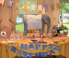 Circus themed party, complete with gold spray painted dollar store animals and homemade gray elephant centerpiece!