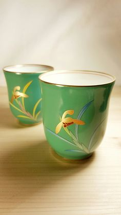 Pair Jade Color Fukagawa Koransha Japanese Porcelain His and Hers Tea Cups with Golden Orchids