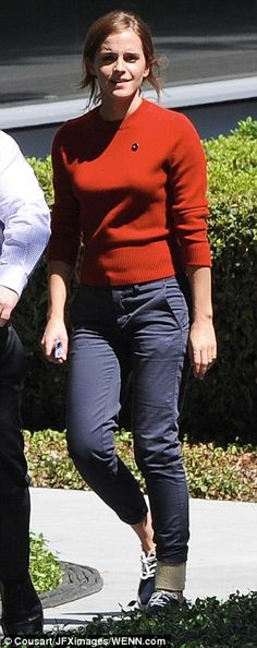 Hard at work? The British actress looked demure in a red knit sweater which she paired wit...