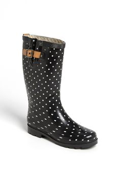 Adding puddle-proof boots with polka dots to the wardrobe this fall.