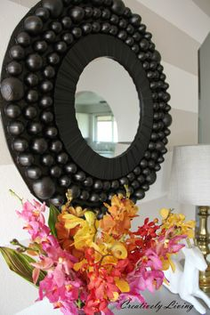 Make a DIY bubble mirror out of easter eggs and orange slices and cardboard by Creatively Living