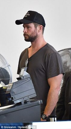 What a hunk! Chris appeared deep in thought as he waited in the airport queue