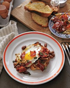 Aromatic stewed beans might be the star of this filling breakfast feast, but toast forms the foundation. Browning the bread in sage-and-garlic-infused bacon fat makes for a flavorful crunch.