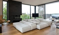 Apartments Modern Glass Wall With Sleek White Bed Design Sofa Also Stunning Heartoak Floor And Modern Natural Wood Flooring With Minimalist Dining Chair Also Contemporary Fireplace Design Sofa Design, Interior Design, My Home Design, House Design, Living Divani, Living Rooms, Desing Inspiration, Natural Wood Flooring, Wood Staircase