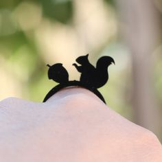Hey, I found this really awesome Etsy listing at https://www.etsy.com/listing/128759396/solid-black-squirrel-and-acorn-ring
