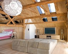 Soft Big Sofas Lie Down Contemporary Family Room: Contemporary Home Theatre With Wooden Slopping Ceiling And Transparent Ceiling Gives The Room Natural Light In The Middle Filled By Grey Big Sofa Bed Very Comforting To Enjoy The Complete Theatre System Perfected