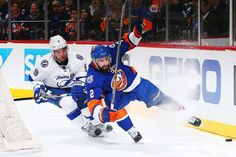 Keeping an edge:        Nick Leddy (2) of the New York Islanders and Tyler Johnson of the Tampa Bay Lightning battle for the puck at the Barclays Center in Brooklyn borough of New York City on May 6.